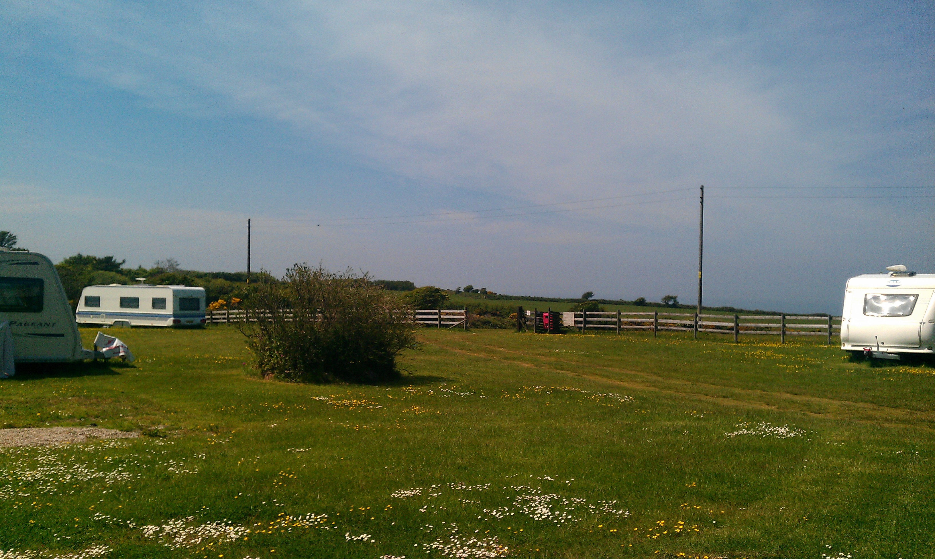 Pitches and Sea Views from Cefn Hedog Caravan and Campsite